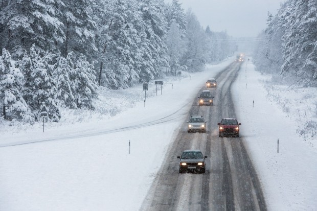 Cars driving on snow road