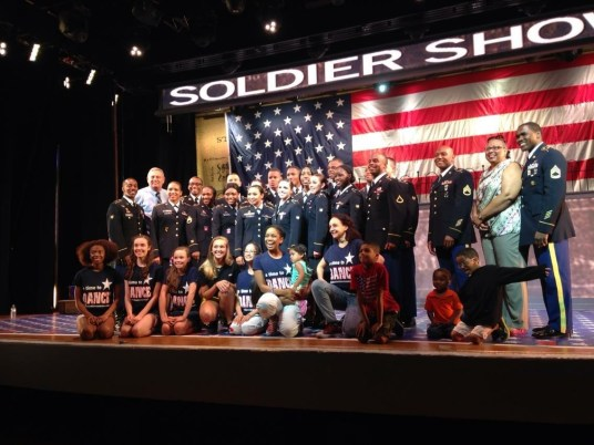 "Onstage with our awesome service men and women in the US Army after their performance of ""The Soldier Show""."