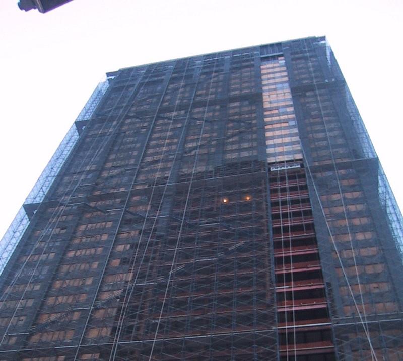 Deutsche Bank Building shrouded in black netting