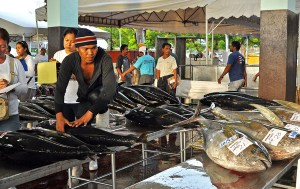 TUNA. A worker sorts out tuna at the Fish Port Complex in General Santos City before they are brought to the factories, exported abroad or sold the local markets. MindaNews File Photo by Jun Ayensa