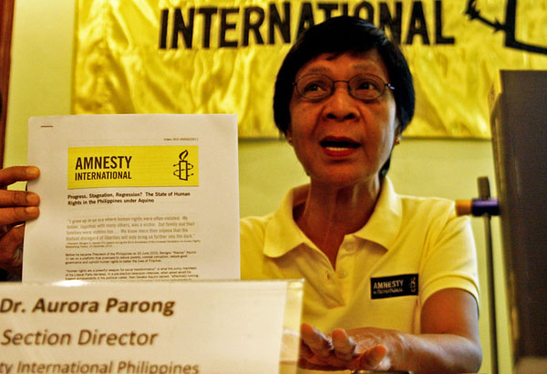 """HUMAN RIGHTS. Dr. Aurora Parong, director of the Amnesty International Philippines, said the human rights situation under President Benigno Aquino III improved """"only a little"""" during a media briefing in Davao City on Friday, July 15, 2011. MindaNews photo by Ruby Thursday More."""
