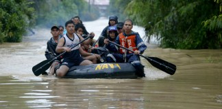 Philippine Navy rescuers navigate through the flooded road as they transport rescued residents from Jade Valley subdvision in Brgy Buhangin, Davao City on January 20. Mindanews Photo by Keith Bacongco