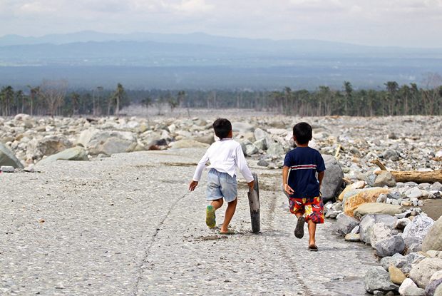 BOYS WILL BE BOYS. Boys find time to play on 28 Jan 2013 amid the destruction caused by Typhoon Pablo in Barangay Andap, New Bataan, Compostela Valley. MindaNews photo by Erwin Mascarinas