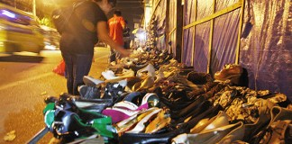 Second hand or ukay-ukay shoes are sold at the sidewalk along Magallanes Street in Davao City on Tuesday, October 1, 2013. MindaNews photo by Ruby Thursday More