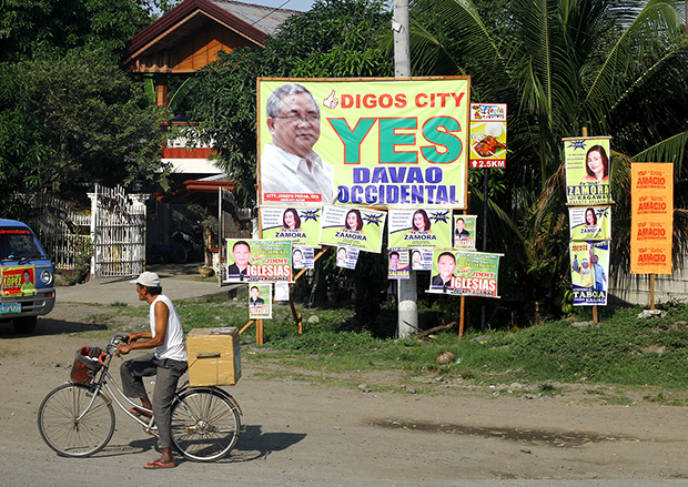 A giant tarpaulin supporting the creation of Davao Occidental province dots the national highway in Digos City in a photo taken on October 24. The plebiscite is set simultaneously with the barangay elections on October 28. The proposed province will cover the towns of Don Marcelino, Jose Abad Santos, Malita (as the capital), Santa Maria and Sarangani. MindaNews photo by Keith Bacongco