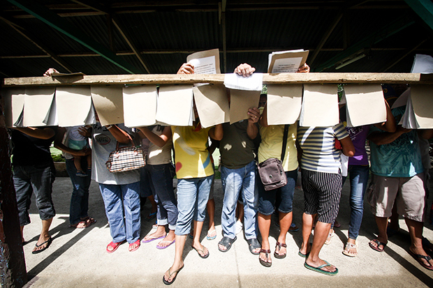 Voters search for their precinct numbers in Sta. Maria, Davao del Sur during the barangay elections on October 28, 2013. The province is also holding a plebiscite for the creation of Davao Occidental province, which covers the towns of Don Marcelino, Jose Abad Santos, Malita, Sta. Maria and Sarangani. MindaNews Photo by Ruby Thursday More