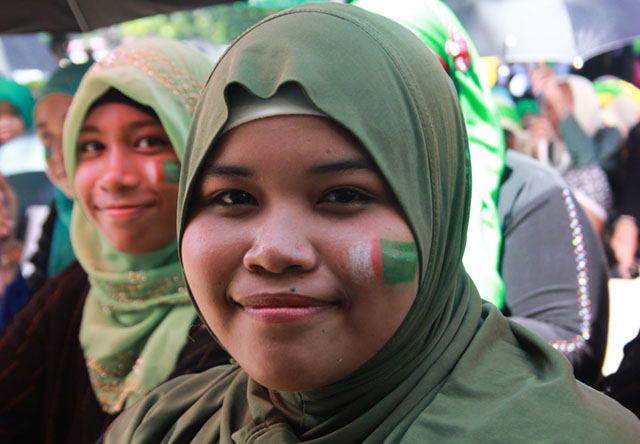 Marguina Dalamban had her face painted with a Bangsamoro emblem as she joins the celebration at the Cotabato City Paza while waiting for the signing of the Comprehensive Agreement on the Bangsamoro between the government and the Moro Islamic Liberation Front on 27 March 2014. MindaNews photo by Toto Lozano