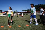 Kids perform warmup exercise during a football clinic in Hagonoy, Davao del Sur on Friday, 25 April. The football clinic is part of the Sports Social School of ANAKK-Sta Cruz, an NGO supported by Fundacion Realmadrid and Fundacion Mapfre. Mindanews Photo by Ruby Thursday More