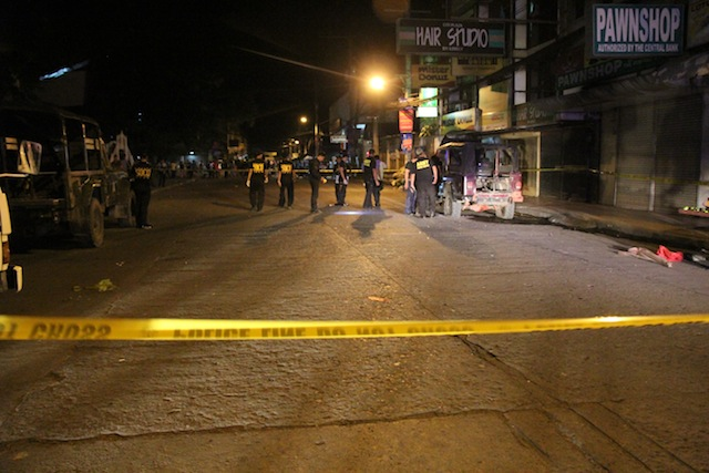 Police cordon off the blast site along Makakua Street in Cotabato City. MindaNews photo by Ferdinandh Cabrera