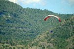 A paraglider prepares to touch down at the landing site in SAFI Ranch 1 in barangay Seguil in Maasim town after flying over Sarangani Bay. File Photo courtesy of Cocoy Sexicon / Saragani PIO