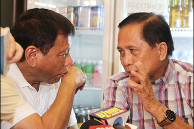 Incoming president Rodrigo Duterte chats with returning Presidential Adviser on the Peace Process Jesus Dureza during a press conference at Hotel Elena in Davao City Saturday night, May 28, 2016. Mindanews photo by KEITH BACONGCO