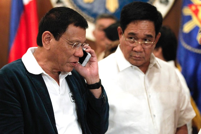 HELLO NUR. President Rodrigo Duterte calls Moro National Liberation Front (MNLF) founding chair Nur Misuari after approving the Peace Roadmap presented by Presidential Adviser on the Peace Process Jesus Dureza at the State Dining Room in Malacañan Palace on Monday evening, July 18, 2016. Beside the President is National Security Adviser Hermogenes Esperon Jr. TOTO LOZANO/PPD