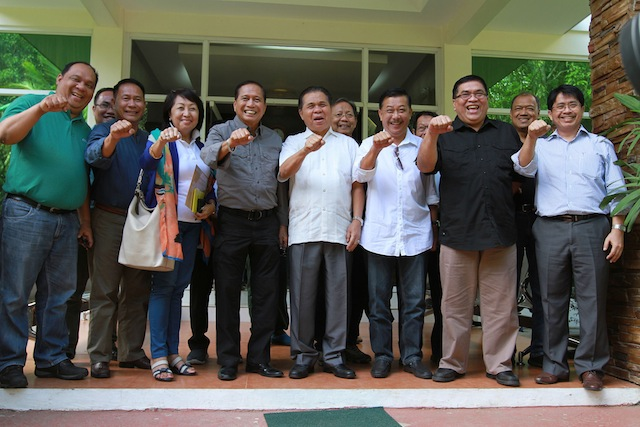 Presidential Adviser on the Peace Process Jesus Dureza and MILF Chair Al Haj Murad Ebrahim and other officials of government and the MILF clench their fists ala President Duterte, for a souvenir photo after Dureza met with Murad and the MILF Central Committee in Camp Darapanan, Sultan Kudarat, Maguindanao early morning Friday, 21 July 2016. MindaNews photo by KEITH BACONGCO