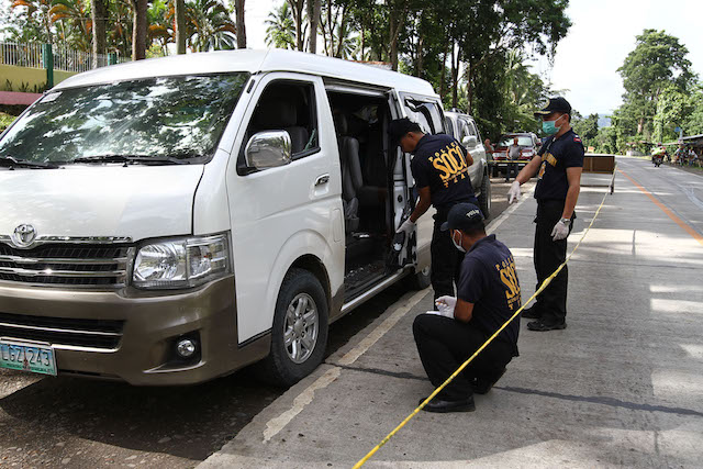 Scene of the Crime operatives check a firearm recovered inside a van following an alleged encounter between the group of suspected druglord Mayor Samsudin Dimaukom of Datu Saudi Ampatuan town in Maguindanao and the police in Makilala, North Cotabato early morning of October 28, 2016. Dimaukom and nine others were killed. Mindanews Photo