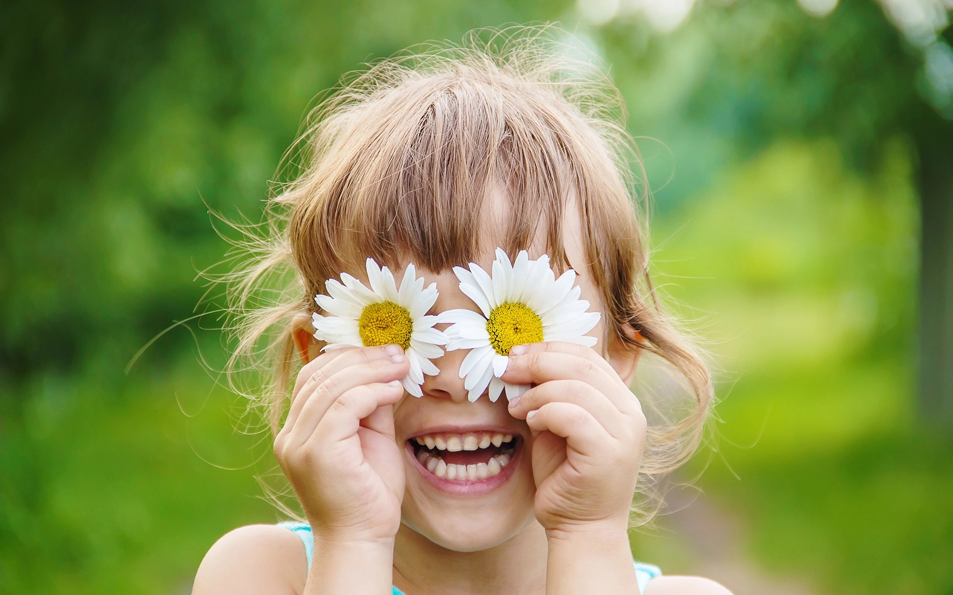 3 Simple Ways to Cultivate Joy Every Day - the girl is holding chamomile flowers in her hands. Selective focus
