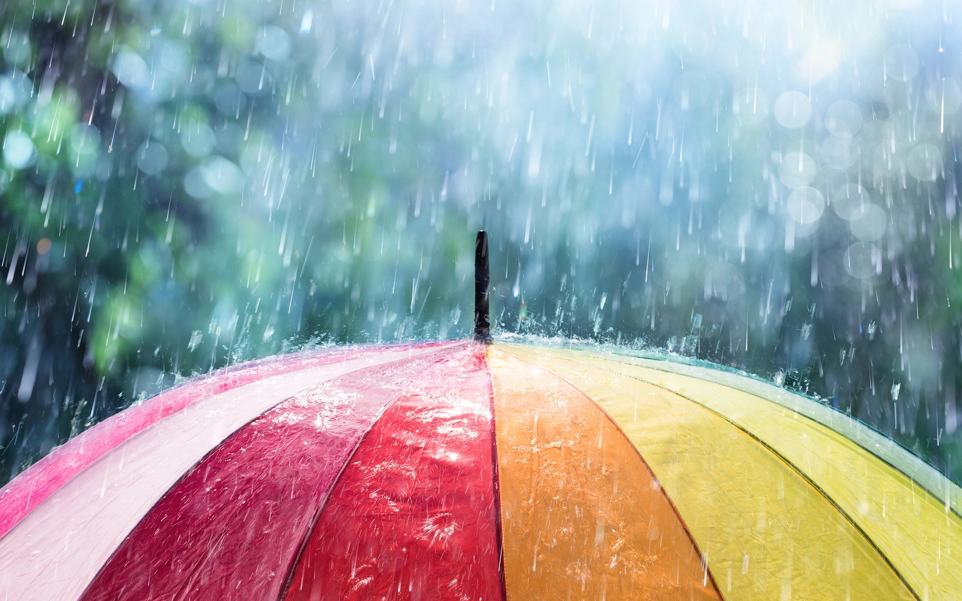 A Guided RAIN Meditation to Cultivate Compassion - Image of rain falling on an umbrella