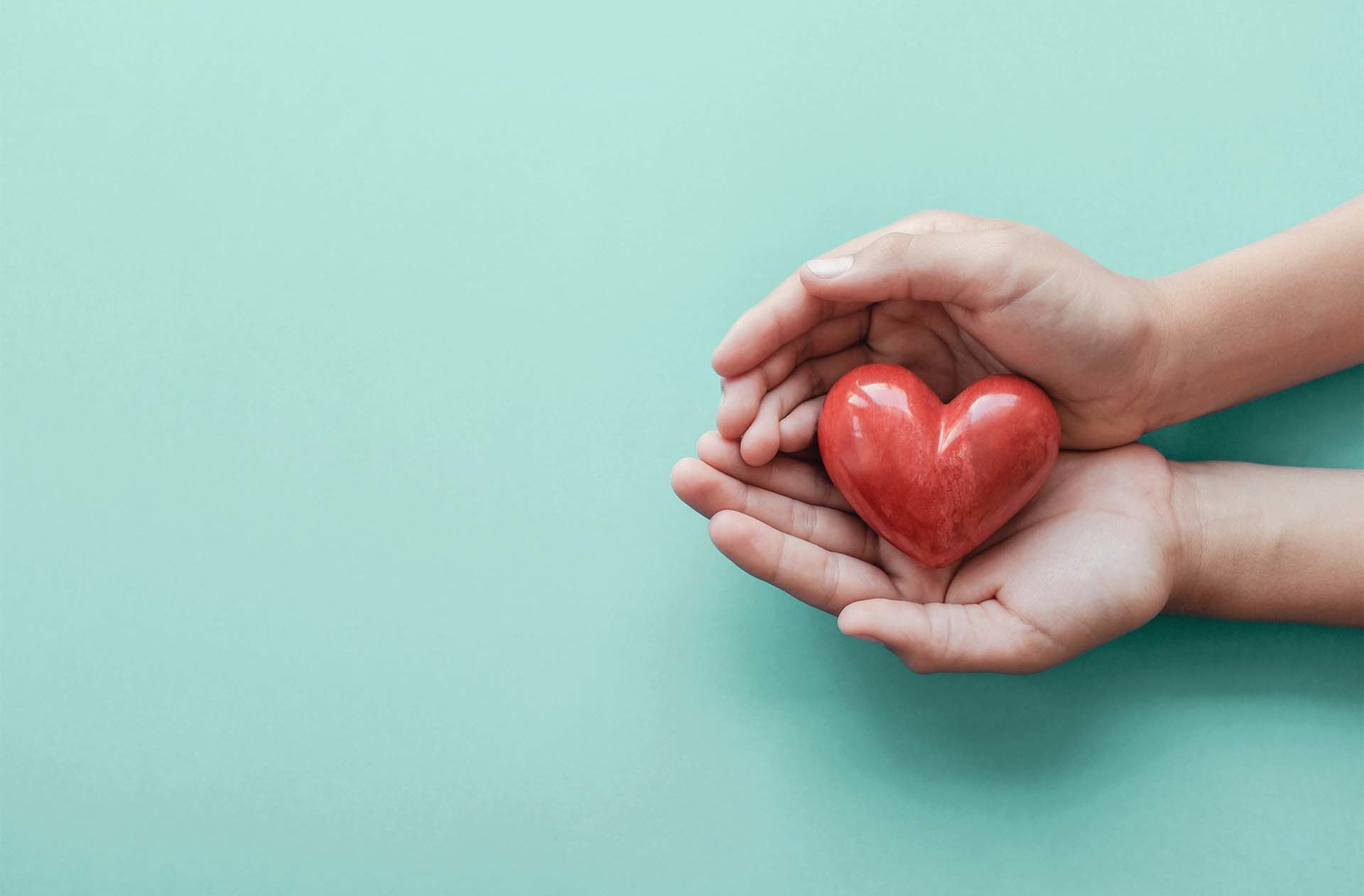 A Practice to Welcome Gratitude with Sharon Salzberg_Two hands holding a red heart
