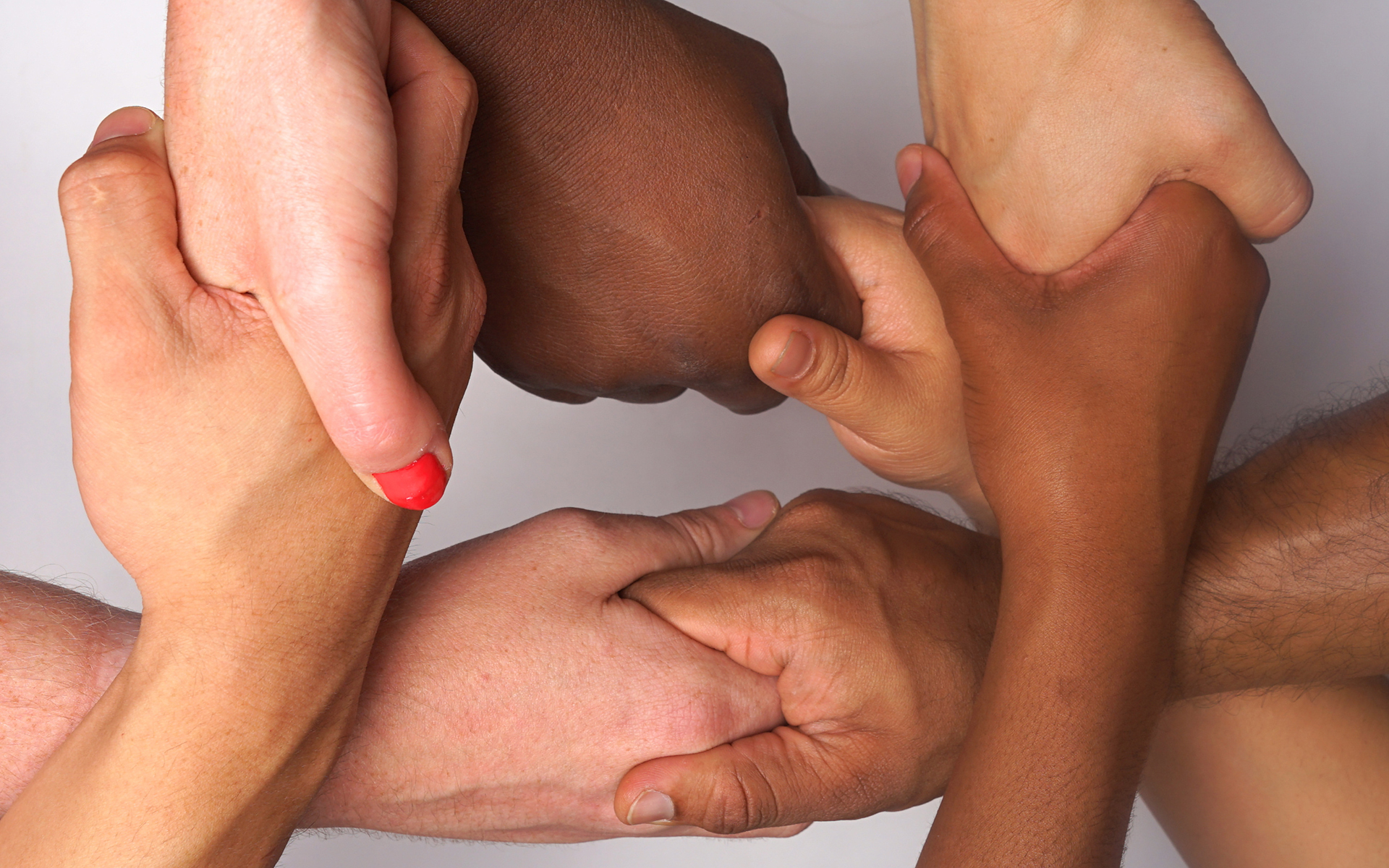 diversity hands in unity. people of color . Racial Harmony