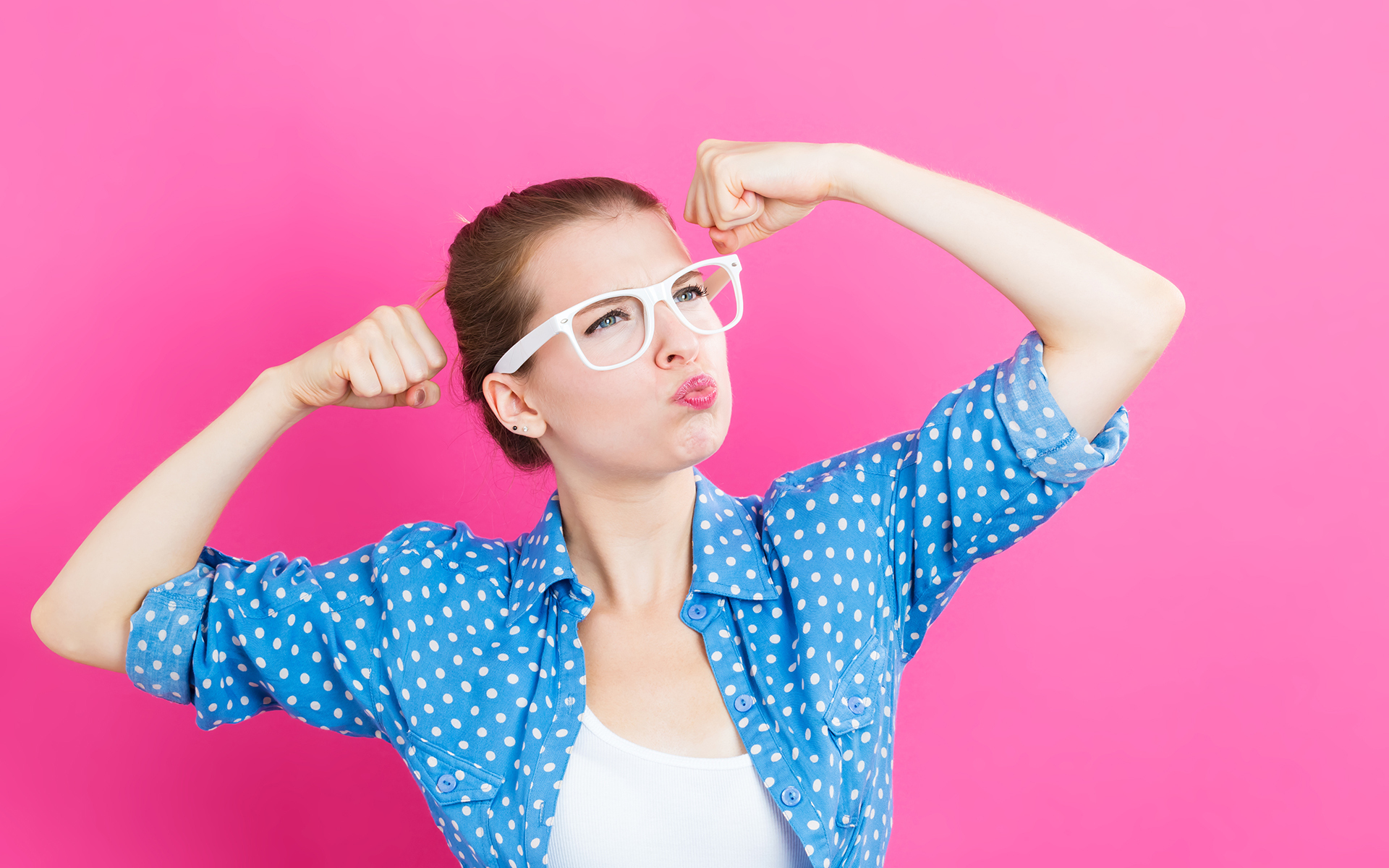 4 Ingredients for Human Well-being - Woman with glasses flexing arms