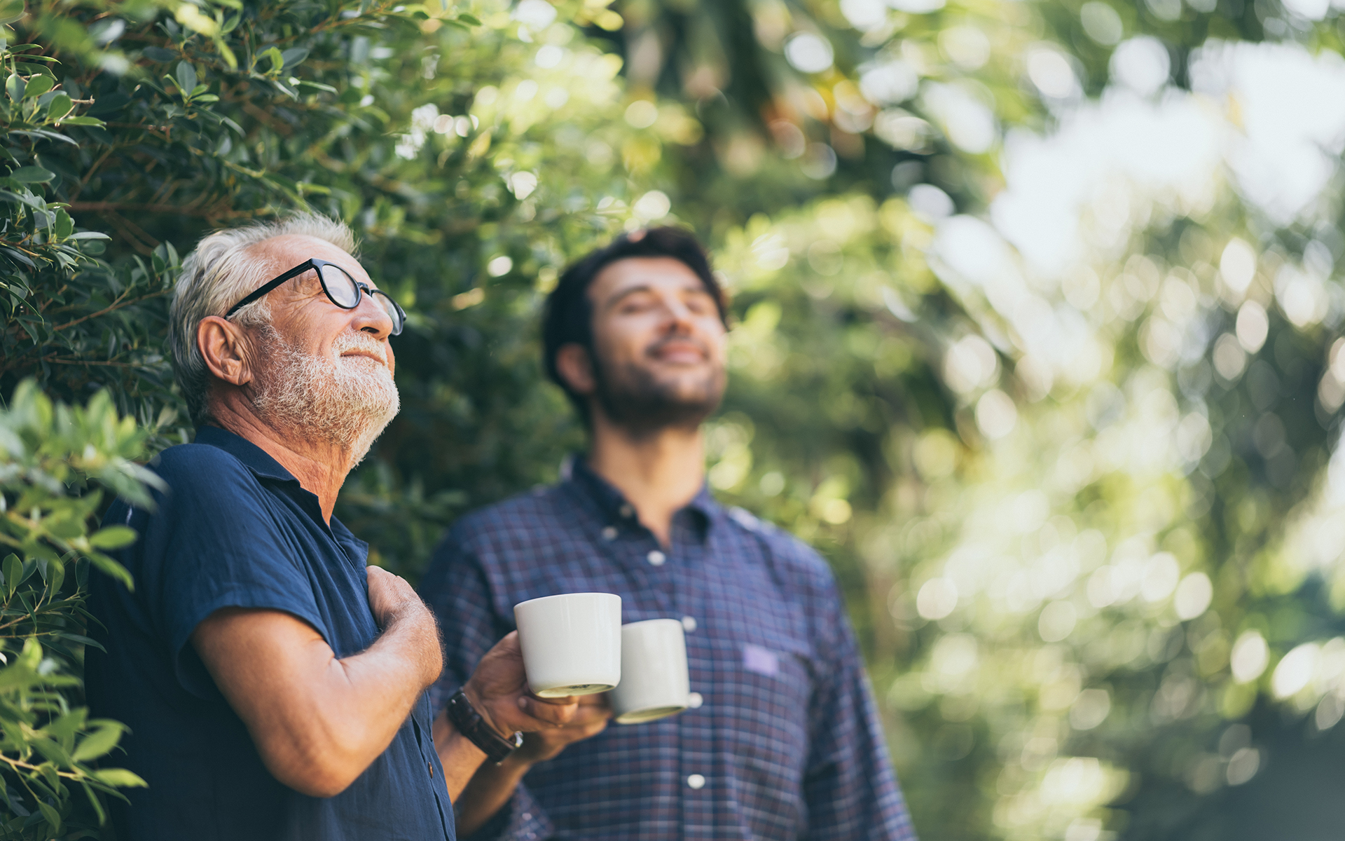 The Importance of Noticing Small Moments of Beauty - Old father and son, Morning coffee in a garden