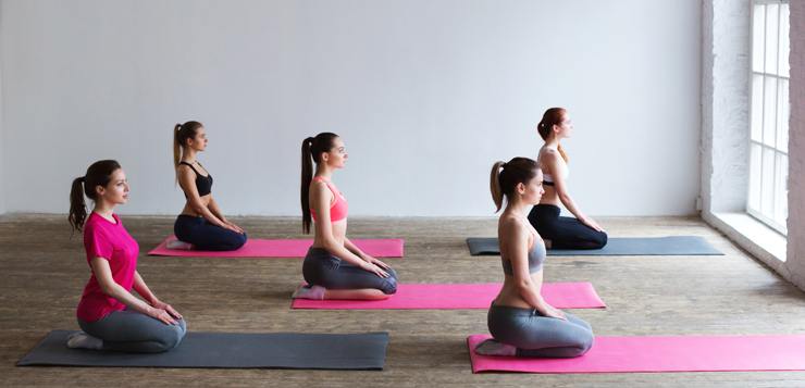 women in seated meditation pose