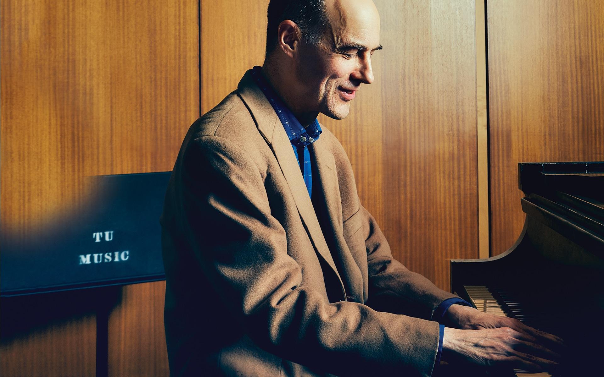 Alexander DeVaron playing the piano