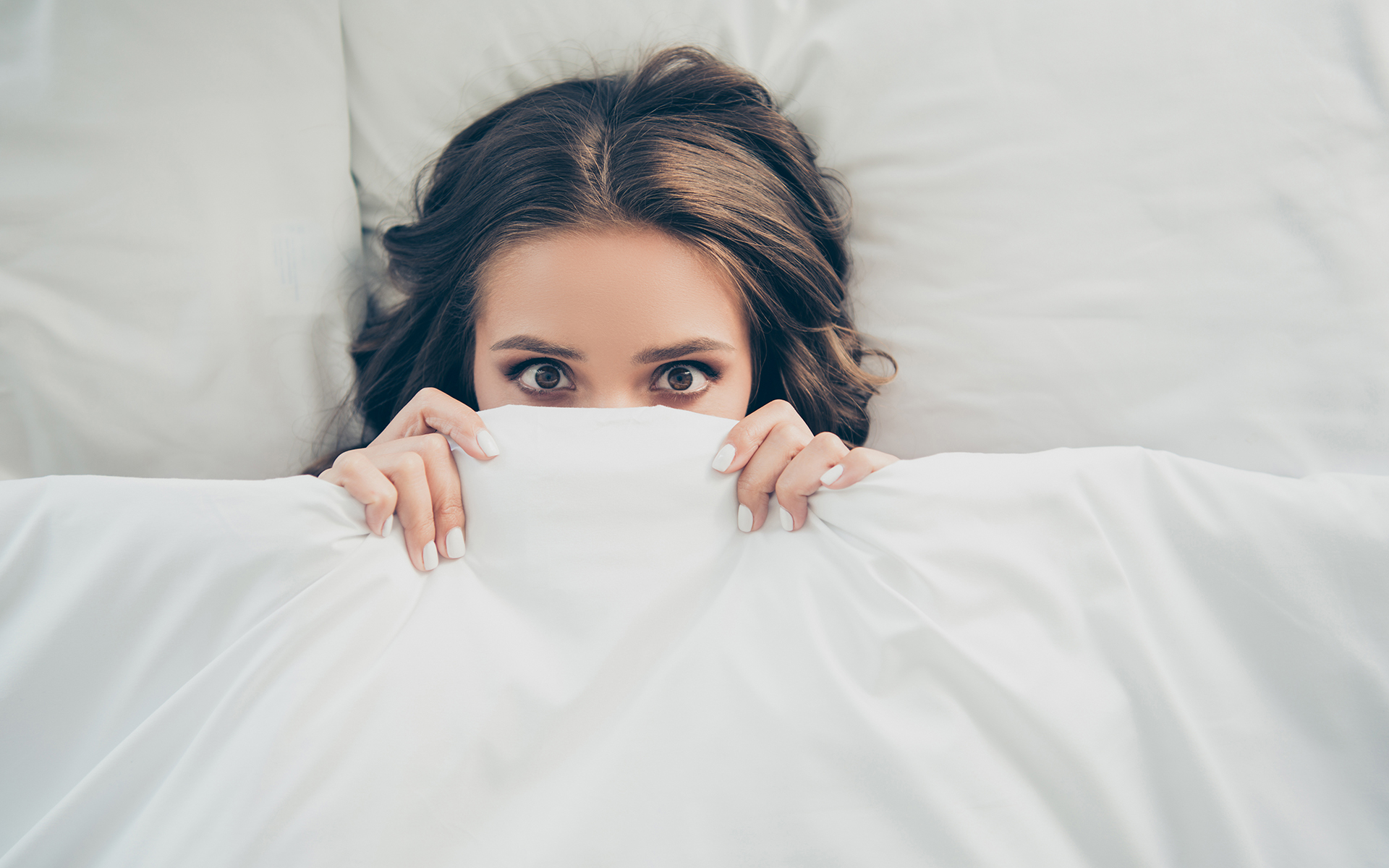 How Mindfulness Can Help You Navigate the Coronavirus Panic - Woman covering her face with a blanket in bed