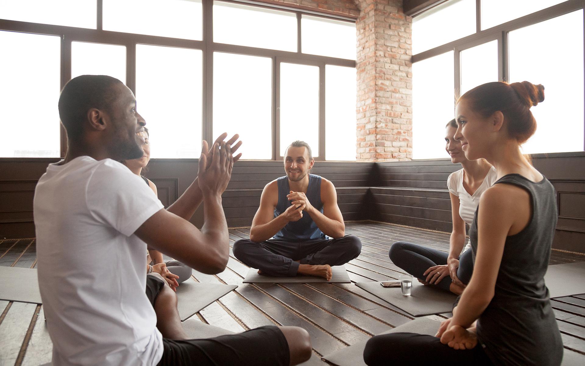meditation teacher talking to students
