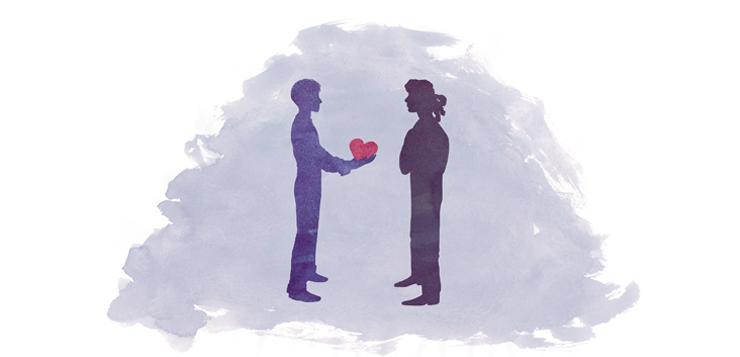 man giving woman a heart