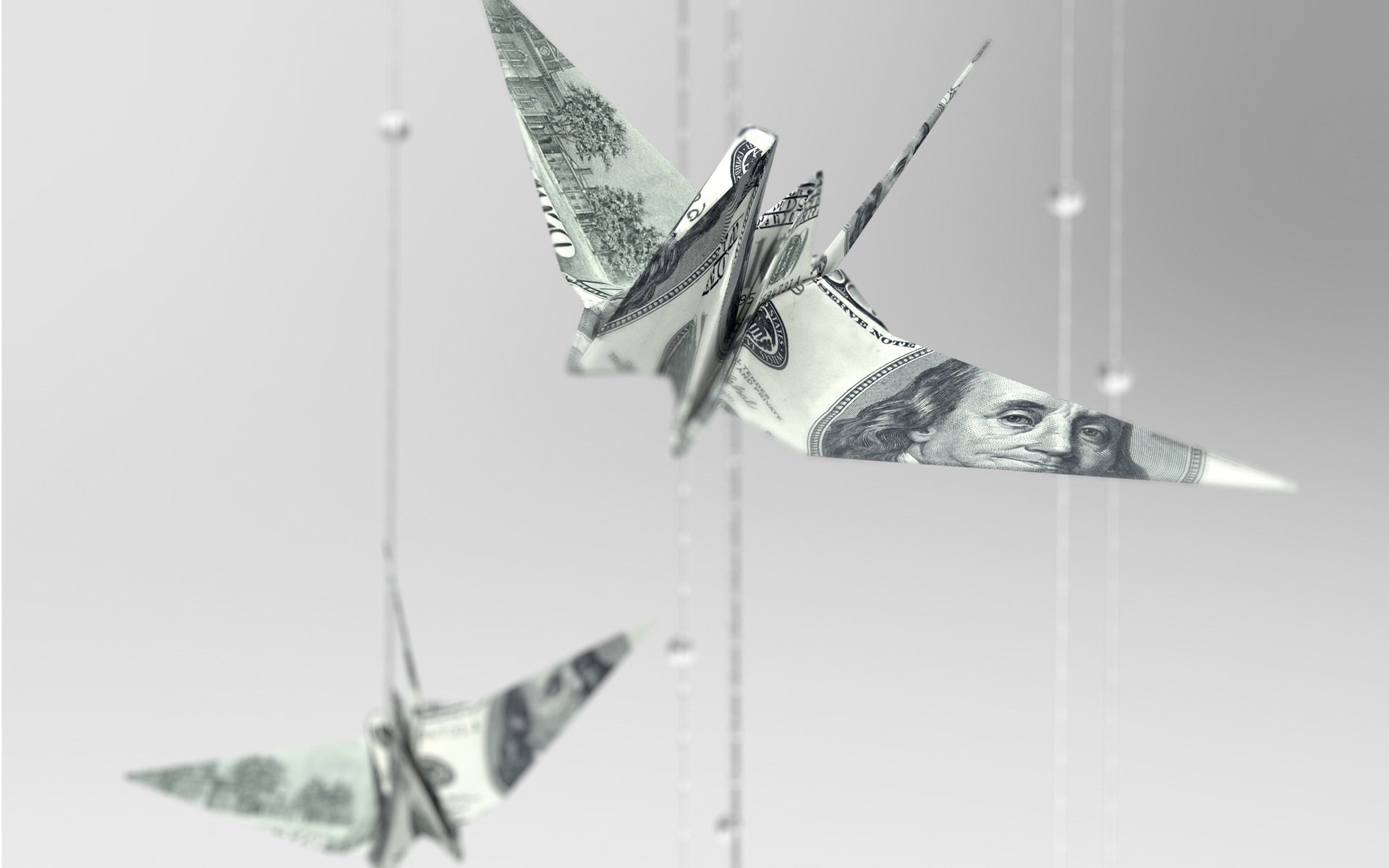 paper cranes made of money