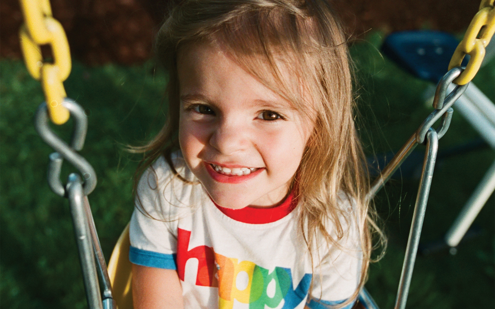 happy girl sitting on a swing