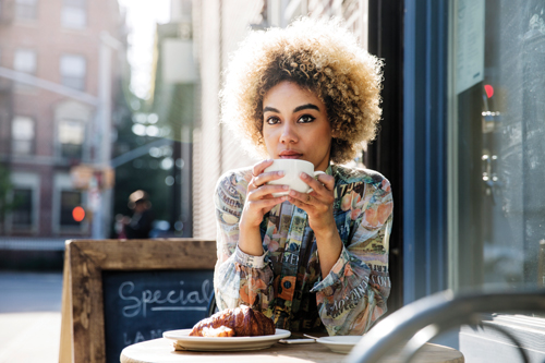 woman enjoying coffee break at a cafe
