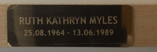 Plaque on picture of Ruth Myles.