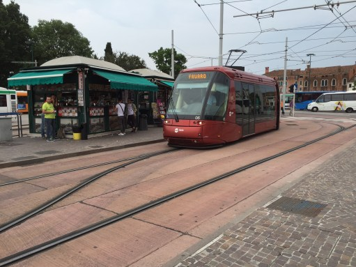 Venice: A tram, with only one central rail - and rubber tyres.