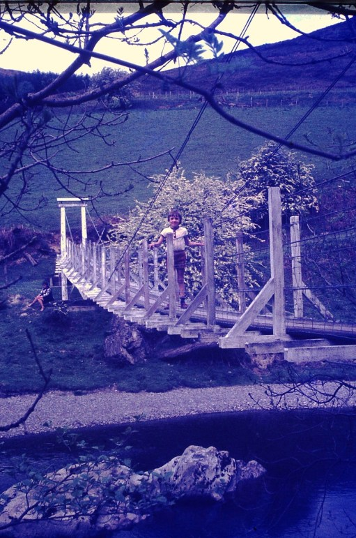 Gigrin Farm: Suspension footbridge, River Wye, 1973. Bobby's son Andrew.