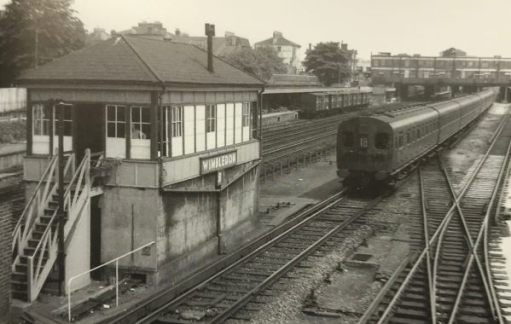 "The Footbridge: 1957 again. A modern, for its day, 4-SUB electric train. The freight vans in the background once again at the ""Milk Dock""."