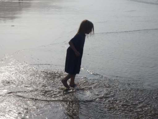 Contre-jour: Layla on Whitby beach. Wear a swimming costume next time!