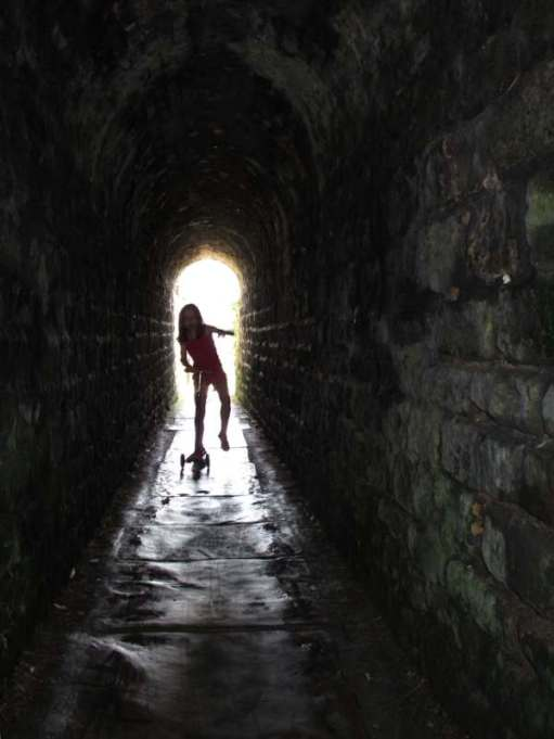 Contre-jour: Layla in a footpath tunnel in Whitby. Whitby... a photographer's dream.