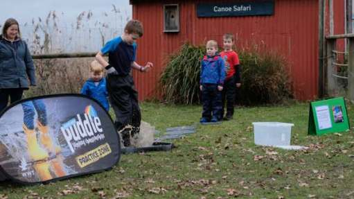 Cotswold Reverie: Puddle jumping championships for children at half term. Many came suitable dressed in waterproof suits for the challenge.