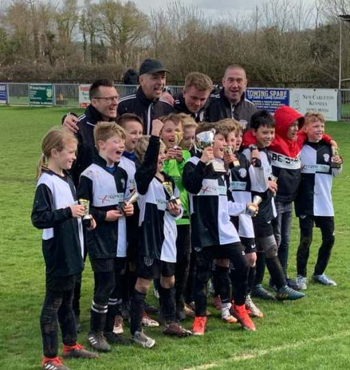 We Won the Cup: East Preston Under Tens and four Dads, plus a new player for the future in red hood.