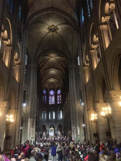 April in Paris: The magnificent nave, in happier times. The cross above the altar survived almost unscathed.