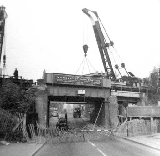 Demolishing the old Worcester Park Bridge.
