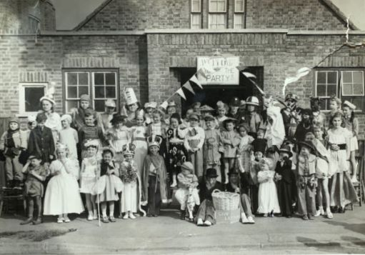 Brocks Drive, North Cheam. Coronation fancy dress party. See the Coronation Clown top left. See the king in the middle front. Bob and Alan. And Chris somewhere in there. This picture appeared on a local group Facebook page recently. Bob, Chris and Alan met in Brocks Drive last year as a result of this picture and are now firm friends.