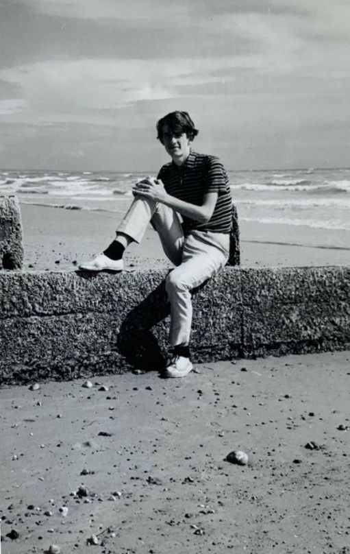 Bobby sat on a groyne on Lancing Beach, with the sea behind him.