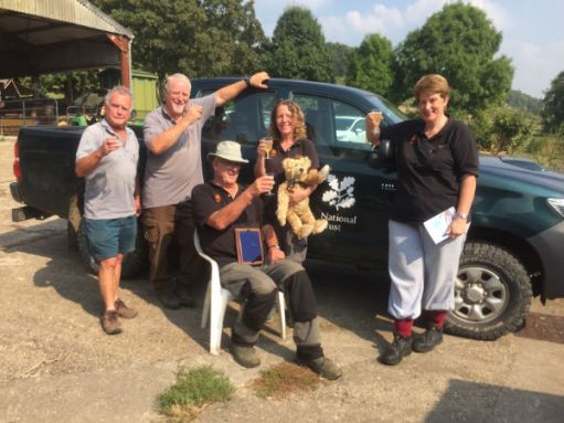 Bobby and Bertie posing with fellow National Trust volunteers by one of their 4x4 cars.