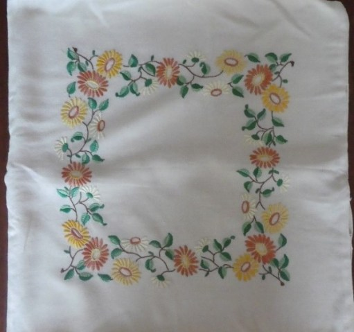 Embroidered flowers in a square pattern.