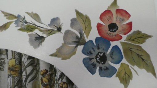 Close-up of embroidered flowers on pelmet decoration.