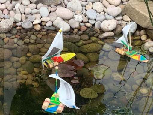 Home-made yachts by children.