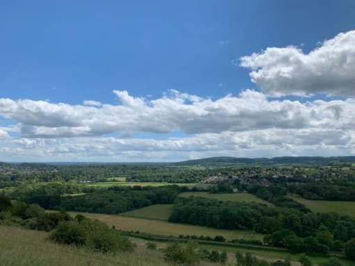 Looking south across the Weald. Small gap, two thirds to the right, is Leith Hill. You can see the Tower. The hill heading down to the middle of the picture is Redlands. At the foot lies South Holmwood and Laurel Cottage. Far beyond is the South Downs, towards Chanctonbury Ring.