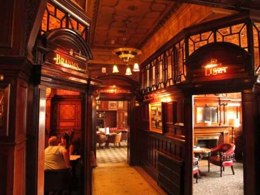 "Inside the ""Phil"". Three doorways named ""Brahms"", ""Liszt"" and ""Grande Lounge""."